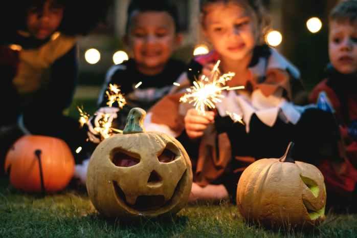 children holding firecrackers outdoors