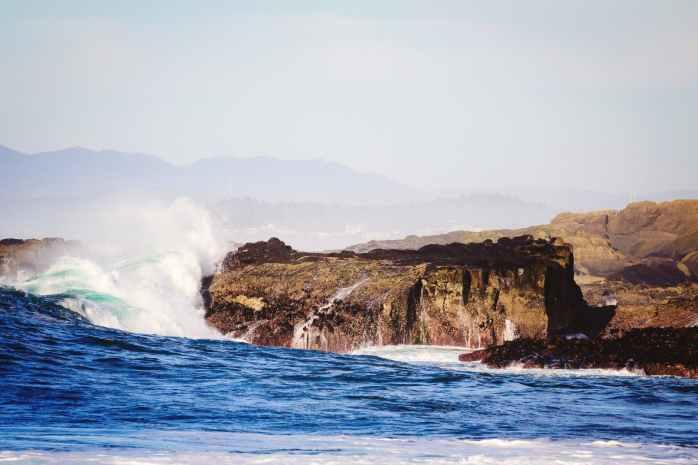 body of water near rocky mountain