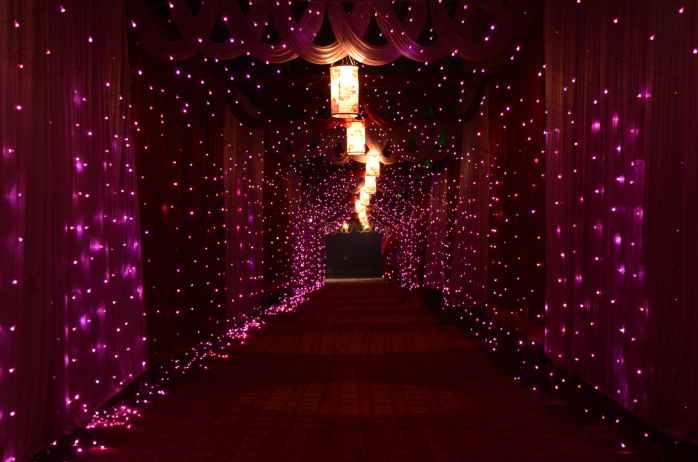 purple string lights and lamps with curtains